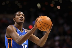 Kevin Durant helped get his team to the NBA Finals in 2012 while claiming his third straight scoring title. (AP Photo)