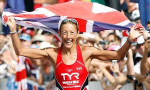 Chrissie Wellington crosses the finish line as she claims her fourth Triathlon World Title. (Bruce Omori/EPA)