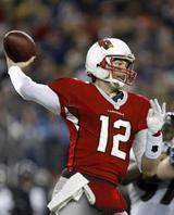 Tom Brady in a Cardinals uniform? Hey, Peyton Manning got kicked out of Indy. (Credit: Eagle-Tribune staff illustration/AP Photo)
