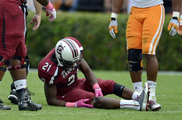 "After suffering a knee injury against Tennessee in October, Marcus Lattimore says he is ""cool"" with the NFL rule that wouldn't allow him to enter last year's draft because he hadn't been out of school for three years (Credit: AP Photo)"