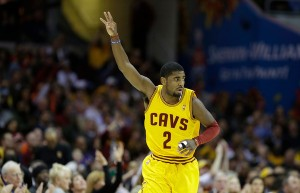 Kyrie Irving celebrates his three-pointer. One of many for the league's best sophomore in 2012-13. (AP Photo/Mark Duncan)