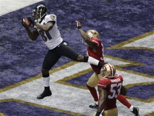 Anquan Boldin played for John Harbaugh in 2012, and will play for Jim Harbaugh in 2013. (Credit: AP Photo/ Charlie Riedel)