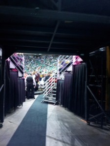 Exiting the tunnel onto the court.