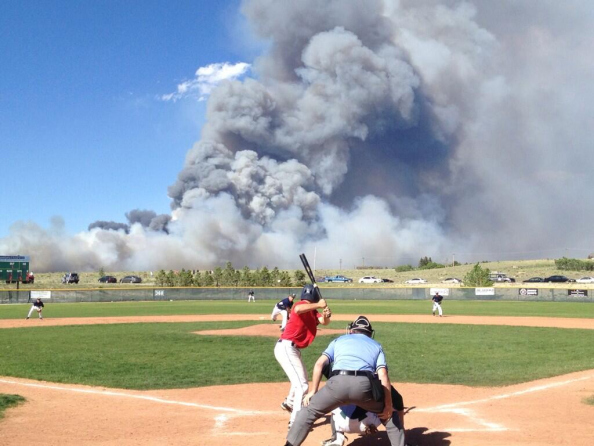 Smoke billows over centerfield in Colorado Credit: @PeterMcEvoy2
