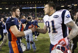 Denver Broncos quarterback Tebow shakes hands with New England Patriots tight end Hernandez after the Patriots defeated the Broncos in their NFL football game in Denver