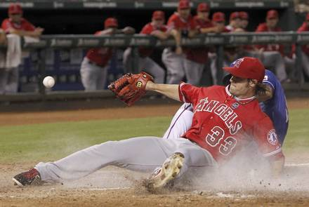 Wilson covers home after uncorking a wild one (Credit: DallasNews.com/Brad Loper)
