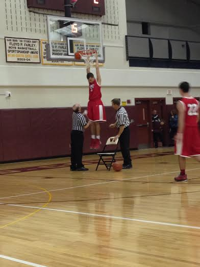 High School JV kid gets stuck on rim after monster dunk